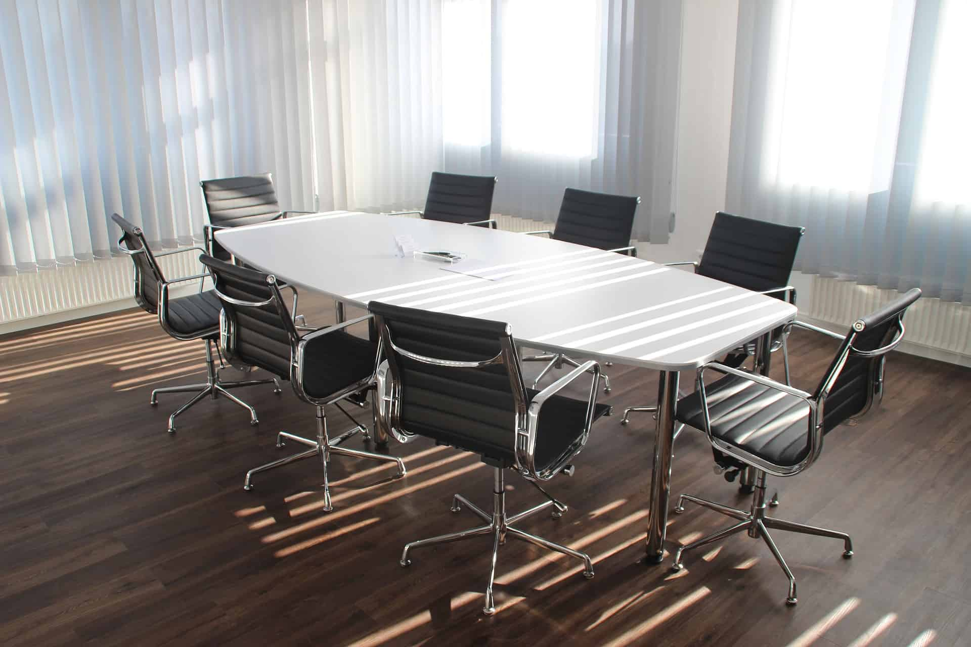 Conference table and chairs in a well-lit room