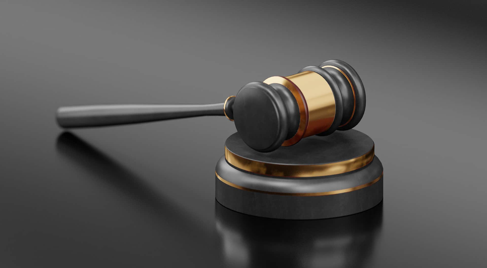 gavel with black and grey background