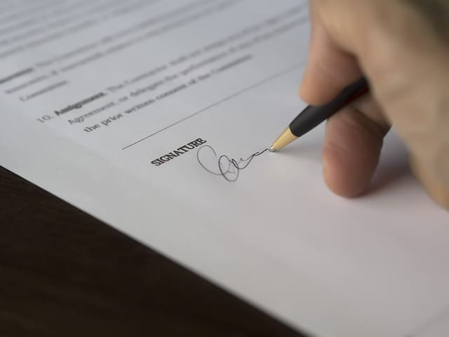 person signing business contract