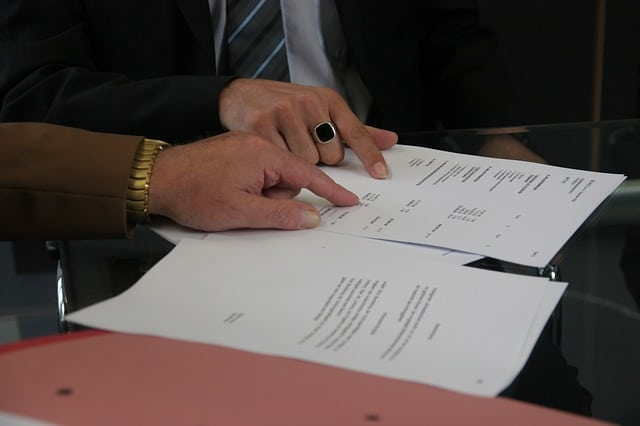 people inspecting a contract