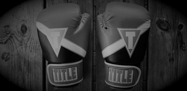 boxing gloves on a wooden table